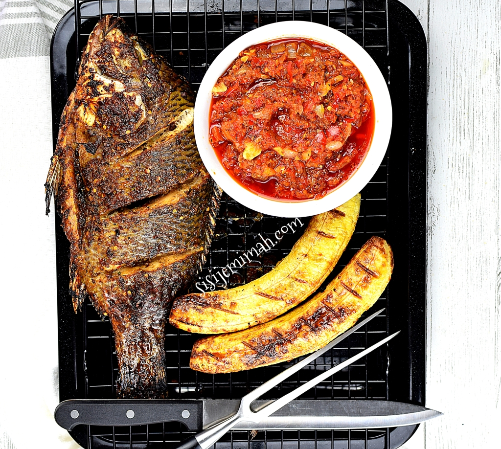 Roasted plantain with pepper sauce and grilled fish