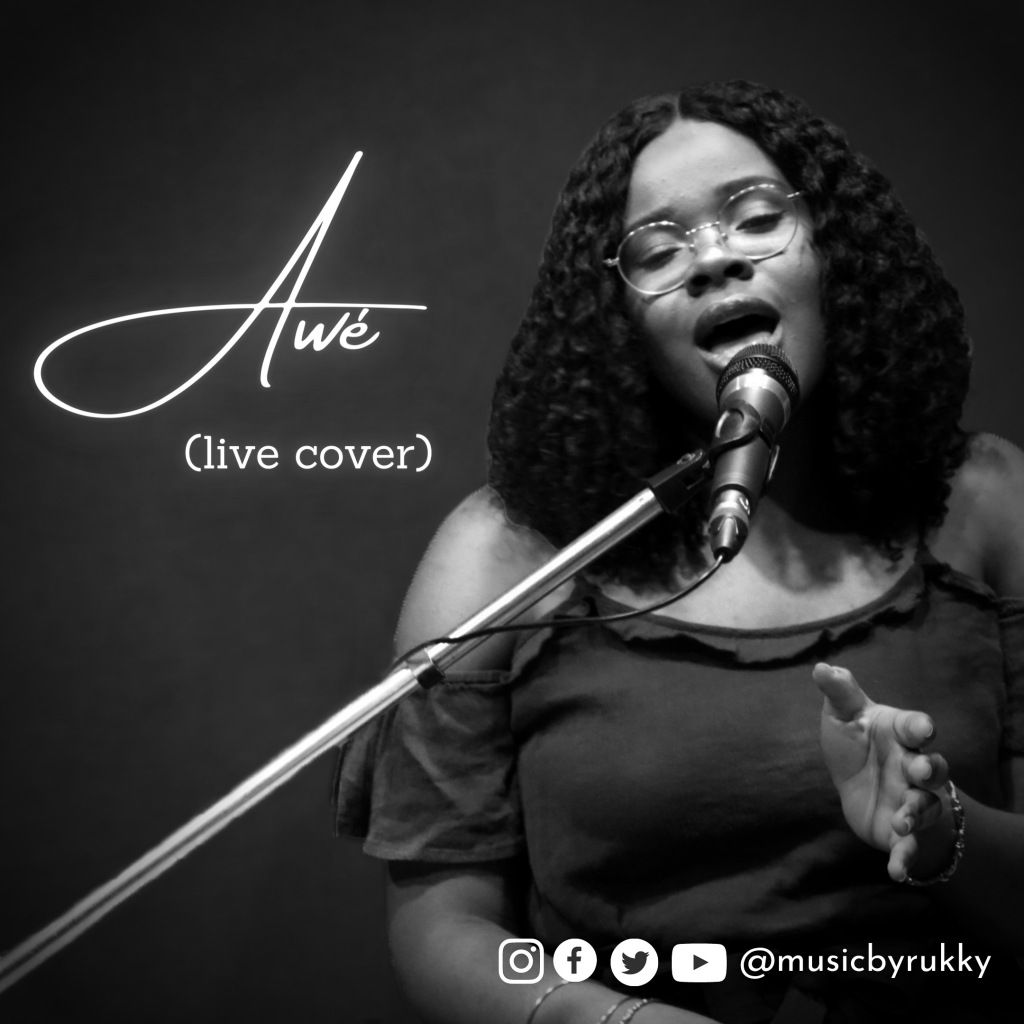 Cover of a song, Awe Live Cover, by Rukky. The singer is singing with a microphone and stand in front of her.