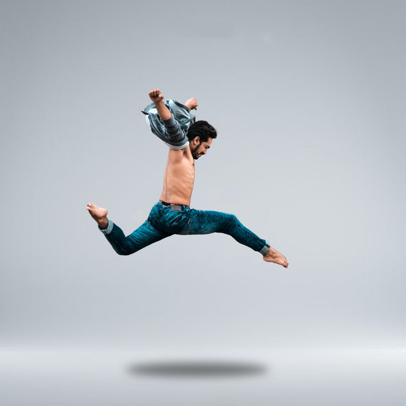 Ballet dancer in the middle of a high jump