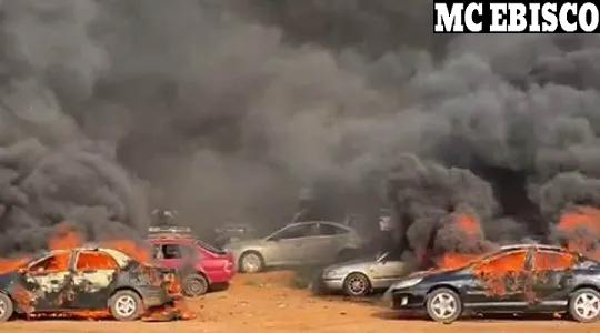 Cars burning with grey smoke filling the air